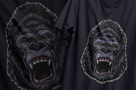 Vintage design of colorful ferocious aggressive angry gorilla head printing on t-shirts
